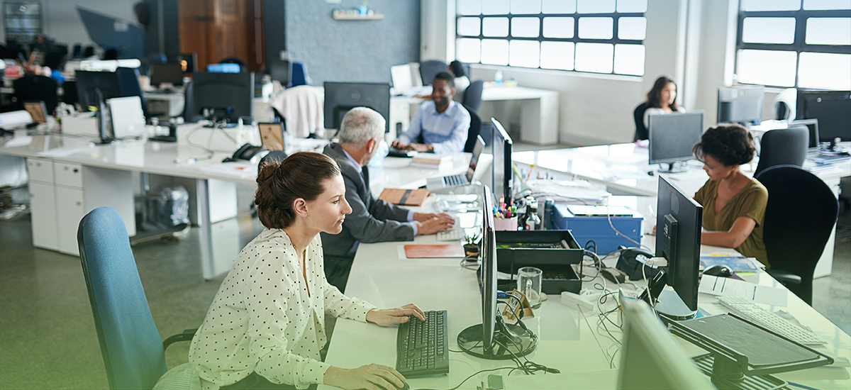 stock-photo-73533915-casually-dressed-workers-in-a-busy-open-plan-office